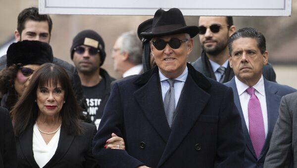 Roger Stone accompanied by his wife Nydia Stone, left, arrives for his sentencing at U.S. District Court in Washington, Thursday, Feb. 20, 2020 - Sputnik International