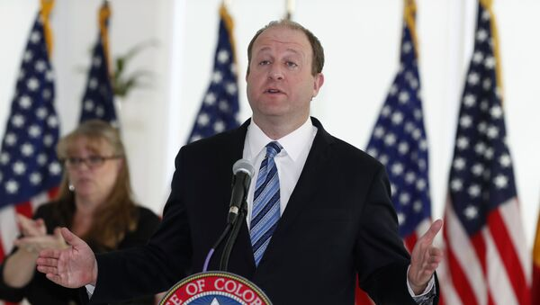 Colorado Governor Jared Polis makes a point during a news conference to update the state's efforts to control the spread of the new coronavirus Friday, April 17, 2020, at the governor's mansion in Denver. - Sputnik International