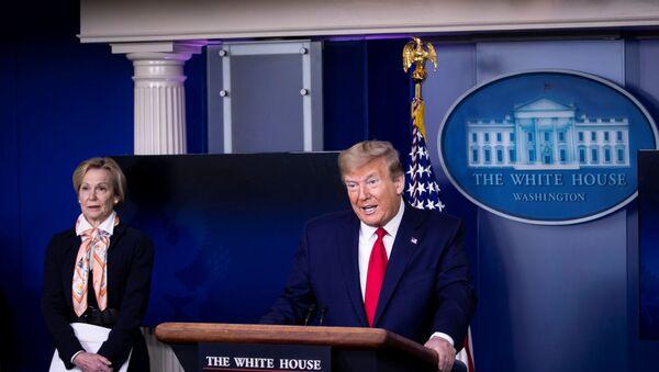 U.S. President Donald Trump speaks at the daily coronavirus task force briefing next to White House Coronavirus Response Coordinator Dr. Deborah Birx in Washington, D.C., U.S., April 18, 2020 - Sputnik International