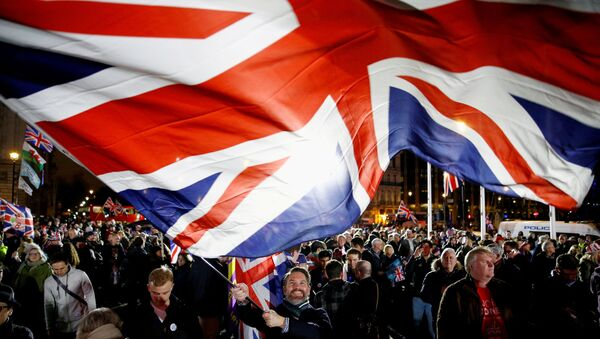 FILE PHOTO: A man waves a British flag on Brexit day in London, Britain January 31, 2020.  - Sputnik International