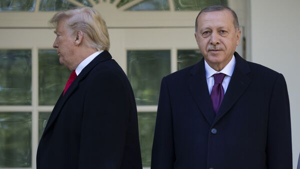 President Donald Trump walks off toward the Oval Office after posing for photographers with Turkish President Recep Tayyip Erdogan before a meeting in the Oval Office of the White House, Wednesday, Nov. 13, 2019, in Washington - Sputnik International