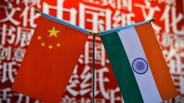 The national flags of India (R) and China are seen at the Delhi World Book fair at Pragati Maidan in New Delhi on January 9, 2016.  - Sputnik International