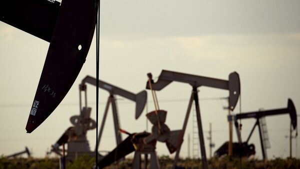 In this April 24, 2015 file photo, pumpjacks work in a field near Lovington, N.M. The United States may have reclaimed the title of the world's biggest oil producer sooner than expected - Sputnik International