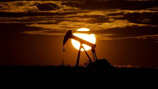 The sun sets behind an idle pump jack near Karnes City, Texas, Wednesday, April 8, 2020. Demand for oil continues to fall due to the new coronavirus outbreak - Sputnik International