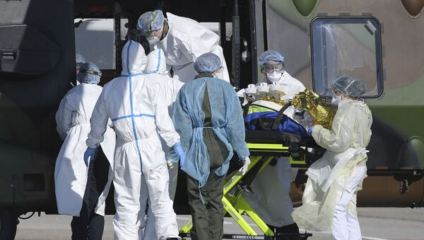 Medical staff push a patient inside a French medical helicopter NH90 of the 1st RHC (1st Combat Helicopter Regiment) in Strasbourg, on March 30, 2020, to be evacuated to a German hospital amid the outbreak of the COVID-19 caused by the novel coronavirus. - Sputnik International