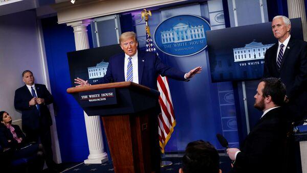 U.S. President Donald Trump speaks as U.S. Vice President Mike Pence listens during the daily coronavirus disease (COVID-19) task force briefing at the White House in Washington, U.S., April 19, 2020 - Sputnik International