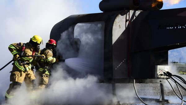 Firefighters from the 355th Civil Engineer Squadron extinguish a fire during training at Davis-Monthan Air Force Base, Ariz., April 14, 2020.  - Sputnik International