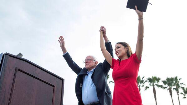 U.S. Senator Bernie Sanders and Representative Alexandria Ocasio-Cortez  during a campaign rally at Venice Beach in Los Angeles, California, U.S., December 21, 2019 - Sputnik International
