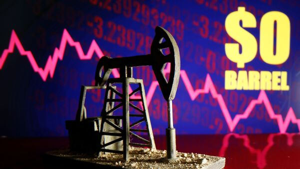 A 3D-printed oil pump jack is seen in front of a displayed stock graph and $0 Barrel words in this illustration picture, April 20, 2020 - Sputnik International