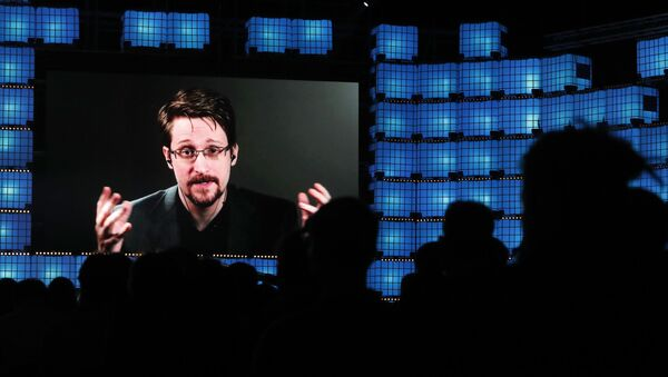 FILE - In this Nov. 4, 2019, file photo, former U.S. National Security Agency contractor Edward Snowden addresses attendees through video link at the Web Summit technology conference in Lisbon - Sputnik International