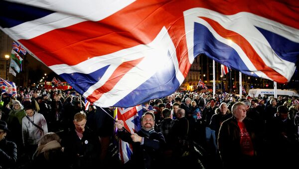 A man waves a British flag on Brexit day in London, Britain January 31, 2020 - Sputnik International
