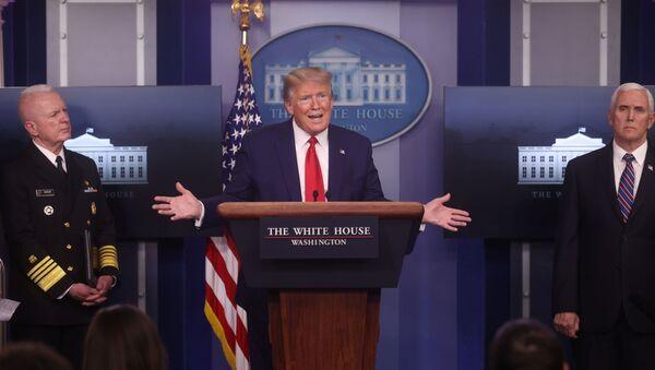 U.S. President Donald Trump addresses the daily coronavirus task force briefing between U.S. Assistant Secretary for Health Admiral Brett Giroir and Vice President Mike Pence at the White House in Washington, U.S., April 20, 2020. - Sputnik International