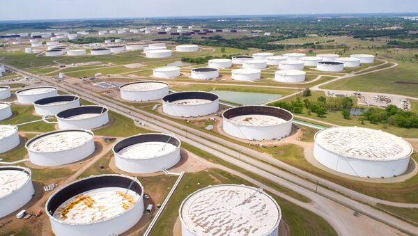 Crude oil storage tanks are seen in an aerial photograph at the Cushing oil hub in Cushing, Oklahoma, U.S. April 21, 2020 - Sputnik International