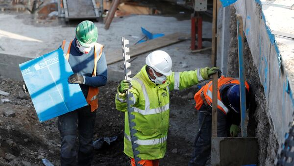 Construction workers work on a site in Chester-le-Street Britain - Sputnik International