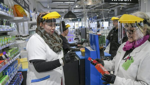 Workers wearing protective clothing are seen, as the spread of the coronavirus disease (COVID-19) continues, in Vantaa, Finland April 1, 2020 - Sputnik International