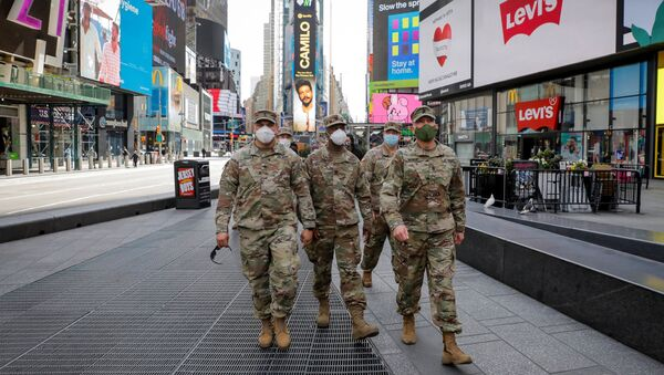 New York State Army National Guard soldiers walk through Times Square, during the outbreak of the coronavirus disease (COVID-19) in New York City, New York, U.S., April 20, 2020 - Sputnik International