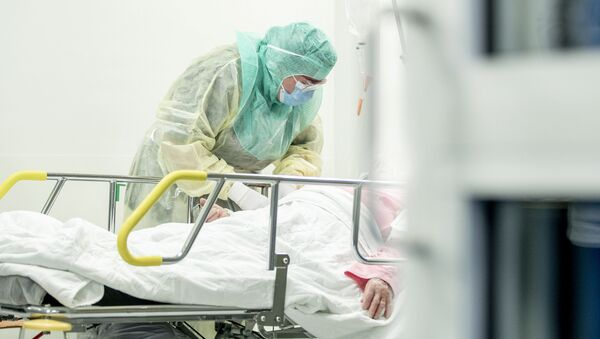 A nurse in protective gear takes a blood sample of a patient potentially infected with coronavirus disease (COVID-19) - Sputnik International