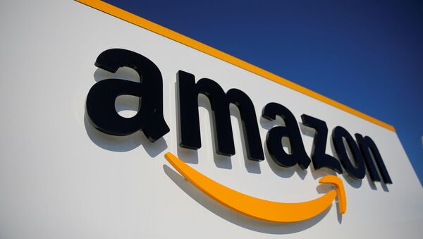 The logo of Amazon is seen at the company logistics center in Lauwin-Planque, northern France, April 22, 2020 after Amazon extended the closure of its French warehouses until April 25 included, following dispute with unions over health protection measures amid the coronavirus disease (COVID-19) outbreak - Sputnik International