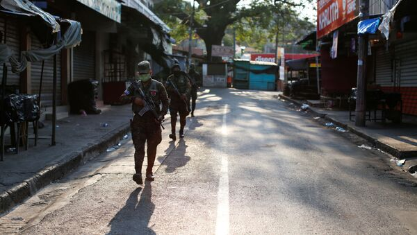 Salvadoran soldiers patrol on a street during a military operation as part of security measures ordered by El Salvador's President Nayib Bukele to keep people inside their homes during a quarantine throughout the country to prevent the spread of the coronavirus disease (COVID-19), in La Libertad, El Salvador April 18, 2020 - Sputnik International