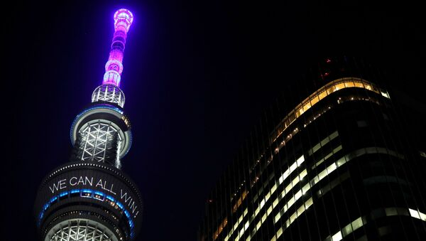 A message reading Together we can all win is displayed at the Tokyo Skytree after Japan's Prime Minister Shinzo Abe declared a state of emergency to fight the coronavirus disease (COVID-19), in Tokyo, Japan April 7, 2020 - Sputnik International