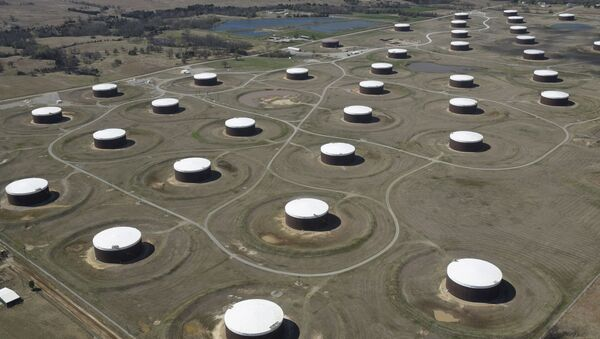 Crude oil storage tanks are seen from above at the Cushing oil hub, in Cushing, Oklahoma, March 24, 2016 - Sputnik International