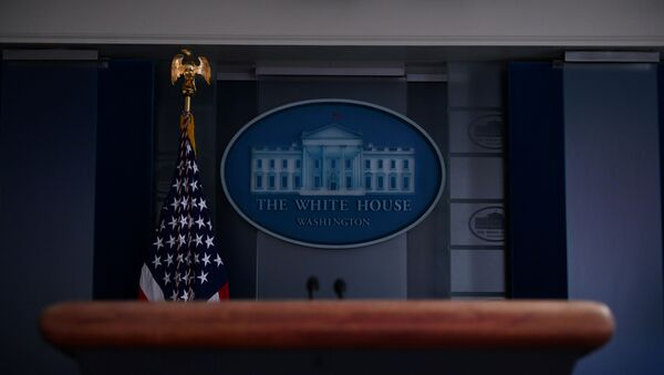 The White House briefing room podium is dark and empty after the coronavirus task force did not hold a briefing for the second day in a row in Washington, U.S., April 26, 2020 - Sputnik International