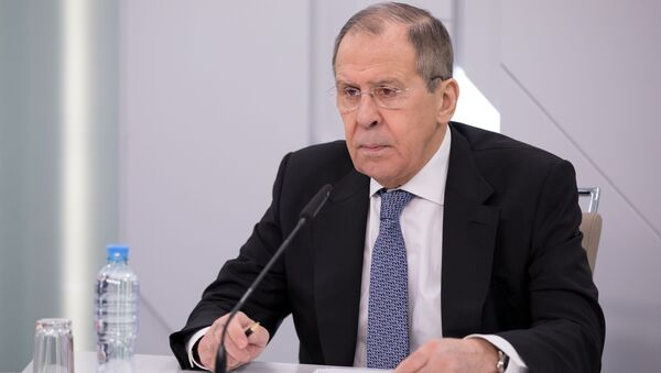 In this handout photo released by the Russian Foreign Ministry, Russian Foreign Minister Sergey Lavrov chairs a video conference meeting with the Alexander Gorchakov Public Diplomacy Fund's Board of Trustees, in Moscow, Russia - Sputnik International
