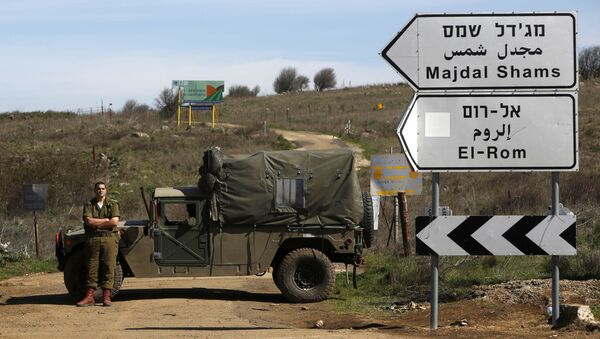 Israeli soldiers block a road leading to the Syrian border in the Israeli-annexed Golan Heights on March 5, 2020. - Syrian air defence responded to Israeli missiles targeting the south and centre of the country, state media said early today. Our air defence confronted an Israeli missile attack in the southwest of Quneitra province in the south and also in a central region, SANA news agency said. The short statement released after midnight did not provide details on the targets. Quneitra province is near the Israeli-annexed Golan Heights.  - Sputnik International