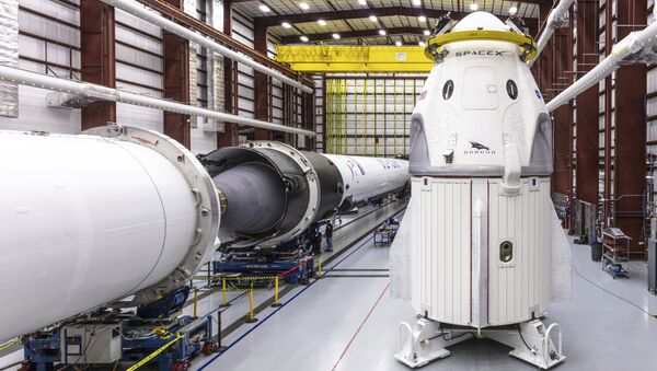 In this Dec. 18, 2018 photo provided by SpaceX, SpaceX's Crew Dragon spacecraft and Falcon 9 rocket are positioned inside the company's hangar at Launch Complex 39A at NASA's Kennedy Space Center in Florida, ahead of the Demo-1 unmanned flight test - Sputnik International