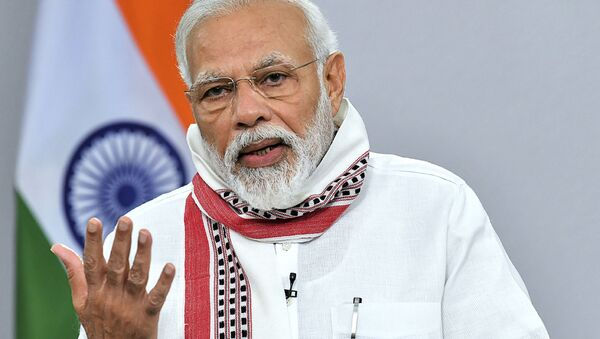 In this handout photo taken and released by Indian Press Information Bureau (PIB) on April 14, 2020, India's Prime Minister Narendra Modi addresses to the nation during a government-imposed nationwide lockdown as a preventive measure against the COVID-19 coronavirus, in New Delhi - Sputnik International