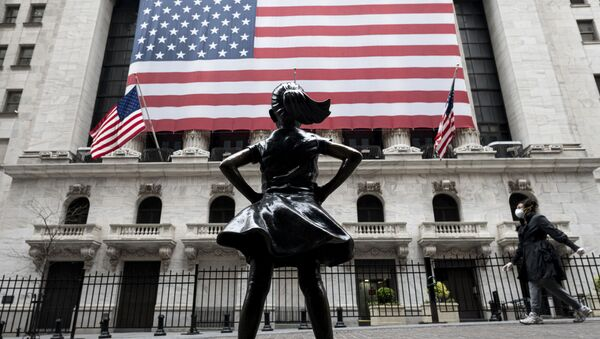 In this file photo The Fearless Girl statue and the New York Stock Exchange (NYSE) are pictured on April 20, 2020 at Wall Street in New York City. - Wall Street stocks jumped early April 28, 2020, extending April's upward trend after mixed earnings from a wide range of large companies. About five minutes into trading, the Dow Jones Industrial Average stood at 24,452.99, up 1.3 percent.The broad-based S&P 500 gained 1.2 percent to 2,913.24, while the tech-rich Nasdaq Composite Index advanced 0.9 percent to 8,807.81. - Sputnik International
