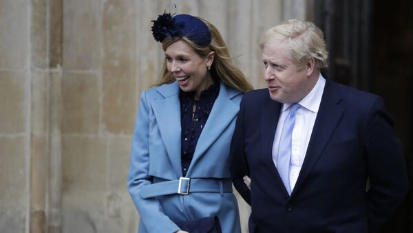 """In this Monday, March 9, 2020 file photo Britain's Prime Minister Boris Johnson and his partner Carrie Symonds arrive to attend the annual Commonwealth Day service at Westminster Abbey in London.  Boris Johnson and his partner Carrie Symonds have announced she gave birth to a healthy baby boy at a London hospital earlier this morning"""" Wednesday April 29, 2020, and that both mother and baby are doing well - Sputnik International"""