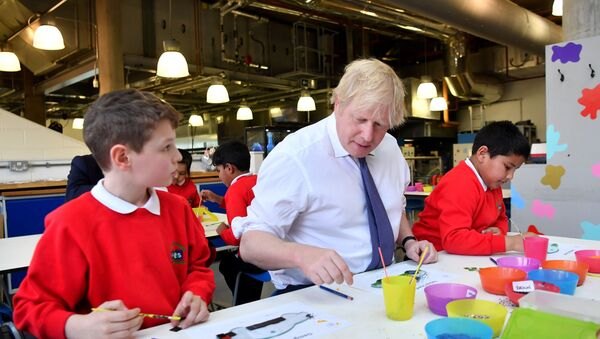 Britain's Prime Minister Boris Johnson (C) participates in a workshop with children from the Richard Avenue Primary School prior to chairing a cabinet meeting at the National Glass Centre at the University of Sunderland, in Sunderland, northeast England on January 31, 2020, the day that the UK formally leaves the European Union - Sputnik International