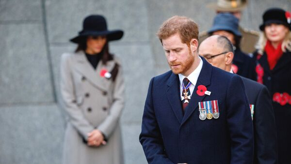 Britain's Prince Harry and his fiancee Meghan Markle, background attend an Anzac Day dawn service, at Hyde Park Corner in London, Wednesday, April 25, 2018 - Sputnik International