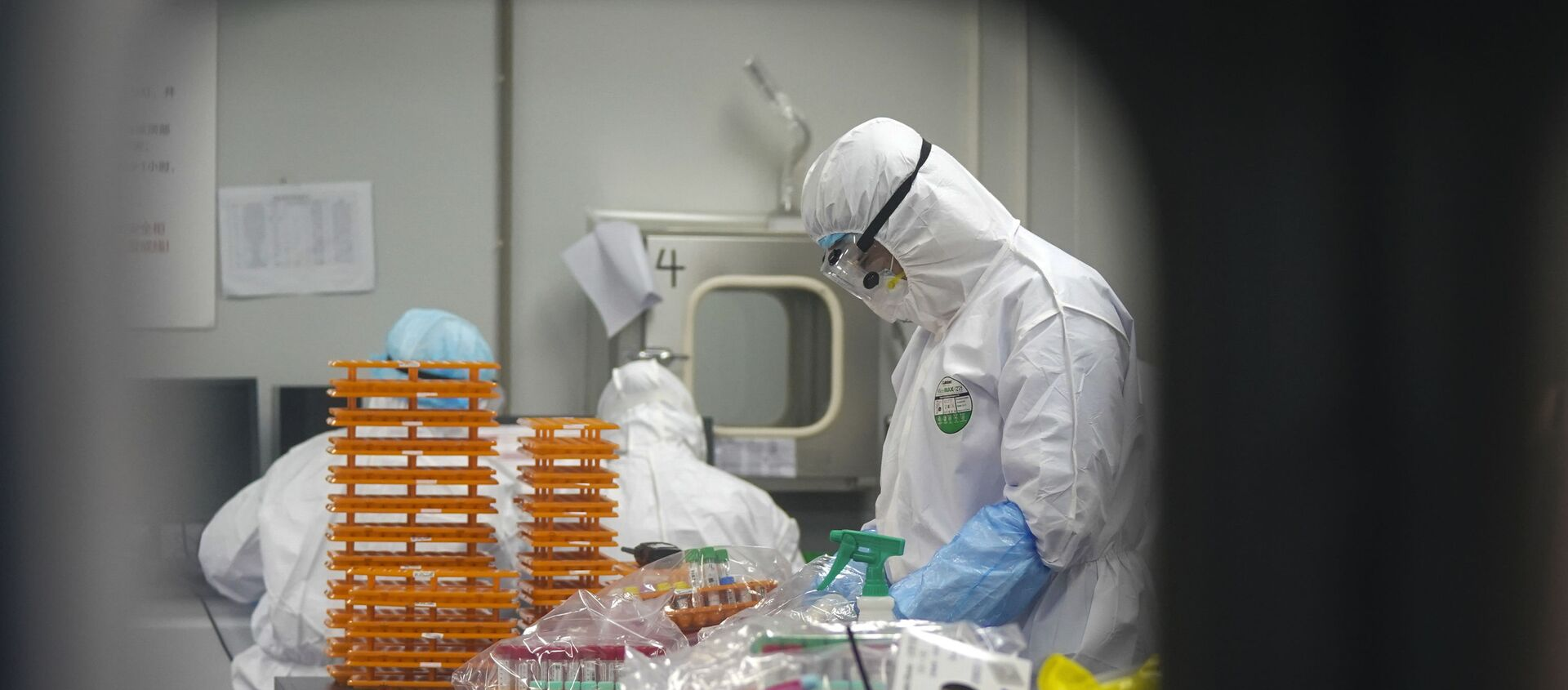 This Saturday, Feb. 22, 2020, photo released by Xinhua News Agency, shows medical workers in protective suits at a coronavirus detection lab in Wuhan in central China's Hubei Province. The fresh national figures for the disease that emerged in China in December came as the number of viral infections soared mostly in and around the southeastern city of Daegu, where they were linked to a local church and a hospital. - Sputnik International, 1920, 06.08.2021