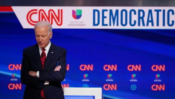 Democratic presidential hopeful former US vice president Joe Biden is seen on stage as he and Senator Bernie Sanders take part in the 11th Democratic Party 2020 presidential debate in a CNN Washington Bureau studio in Washington, DC on March 15, 2020. - Sputnik International