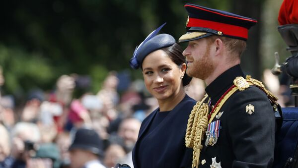 In this 8 June, 2019 file photo, Meghan Markle and Prince Harry ride in a carriage to attend the annual Trooping the Colour Ceremony in London - Sputnik International
