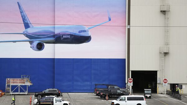 Activity begins to return at the massive Boeing airplane production plant Tuesday, April 21, 2020, in Everett, Wash. Boeing this week is restarting production of commercial airplanes in the Seattle area, putting about 27,000 people back to work after operations were halted because of the coronavirus. - Sputnik International