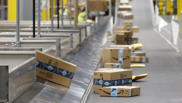 In this Dec. 17, 2019, file photo, Amazon packages move along a conveyor at an Amazon warehouse facility in Goodyear, Ariz. Amazon will report quarterly earnings on Thursday, APril 30, 2020, providing a first glimpse into its financial performance during the pandemic - Sputnik International