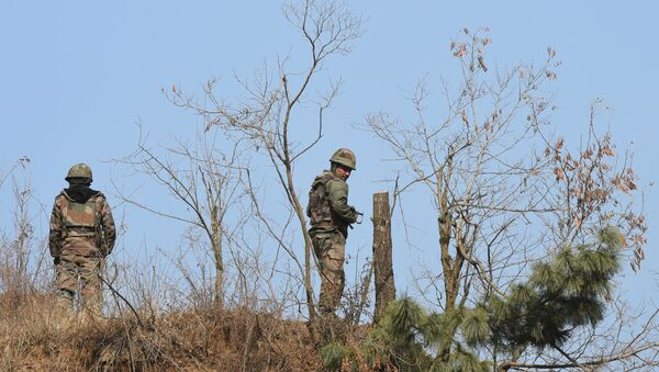Indian army personnel patrol near the site of a gunbattle between Indian troops and suspected militants at Pakharpora in the district of Budgam  - Sputnik International