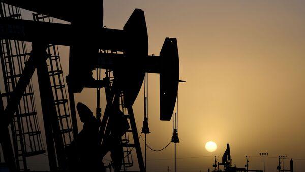 Pump jacks operate at sunset in Midland, Texas, U.S., February 11, 2019 - Sputnik International