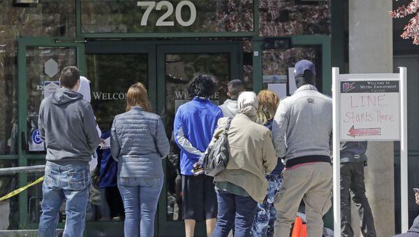 People line up outside the Utah Department of workforce Services Monday, April 13, 2020, in Salt Lake City. - Sputnik International
