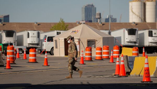 A U.S. Army National Guard soldier walks outside a temporary morgue, during the outbreak of the coronavirus disease (COVID-19) in the Brooklyn borough of New York City, U.S., May 5, 2020 - Sputnik International