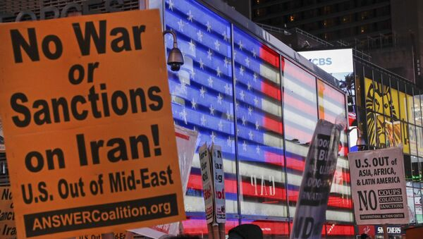 Protesters gather in Times Square Wednesday, Jan. 8, 2020, in New York. The U.S. and Iran stepped back from the brink of possible war Wednesday, as President Donald Trump indicated he would not respond militarily after no one was harmed in Iran's missile strike on two Iraqi bases housing U.S. troops. - Sputnik International