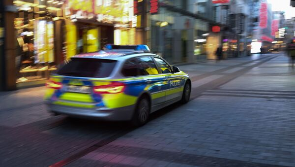 A police car drives through the pedestrian zone in Cologne, western Germany, on March 23, 2020 during the novel coronavirus COVID-19 pandemeic - Sputnik International