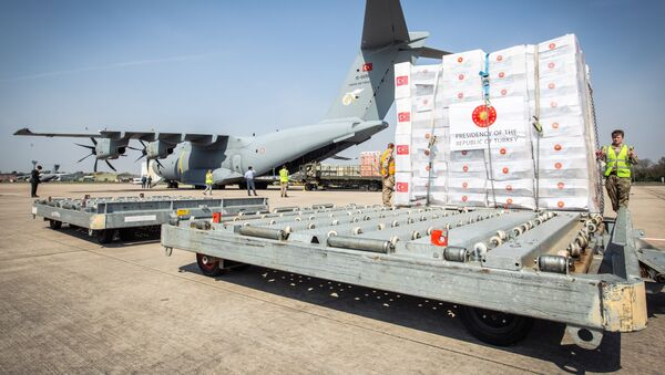 Crucial supplies of personal protective equipment (PPE) for medical staff are delivered from Turkey into a Royal Air Force base for distribution around the country, amid the coronavirus disease (COVID-19) outbreak, in Carterton, Britain, April 10, 2020 - Sputnik International