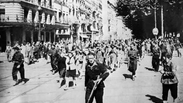 French collaborators are marched through the streets of Lyon in 1945 - Sputnik International
