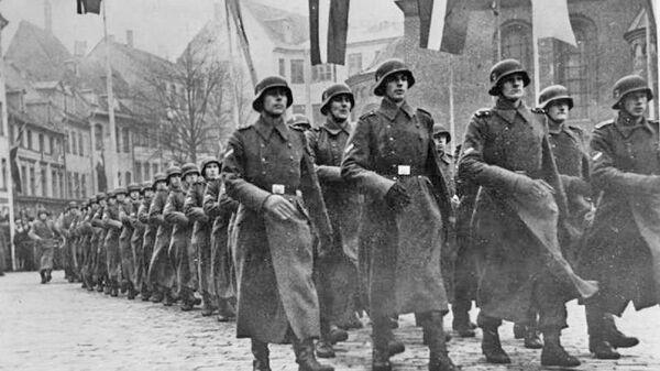 The Latvian SS Volunteer Legion on parade celebrating the 25th anniversary of National Latvia Day. Scherl photo service, 2 Dec 43 - Sputnik International