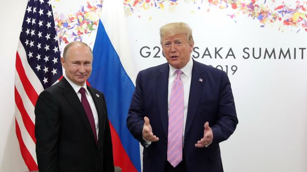 U.S. President Donald Trump, right, and Russian President Vladimir Putin pose for a photo during a bilateral meeting on the sidelines of the G-20 summit in Osaka, Japan, Friday, June 28, 2019. - Sputnik International