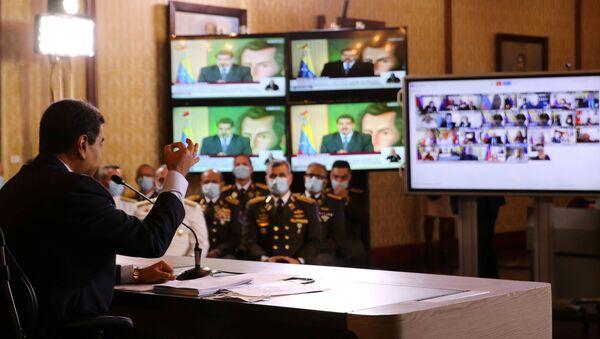 Screens are seen as Venezuela's President Nicolas Maduro holds a virtual news conference in Caracas, Venezuela May 6, 2020.  - Sputnik International